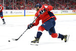 Washington Capitals left wing Alex Ovechkin (8), of Russia, takes a shot during the second period of an NHL hockey game against the Carolina Hurricanes, Saturday, Oct. 5, 2019, in Washington. (AP Photo/Nick Wass)