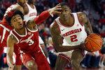 Georgia's Jordan Harris (2) looks to shoot while defended by Arkansas guard Desi Sills (3) during an NCAA college basketball game in Athens, Ga., Saturday, Feb. 29, 2020. (Joshua L. Jones/Athens Banner-Herald via AP)