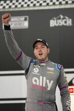 Alex Bowman (48) celebrates winning the NASCAR Cup Series auto race in victory lane at Richmond International Raceway in Richmond, Va., Sunday, April 18, 2021. (AP Photo/Steve Helber)