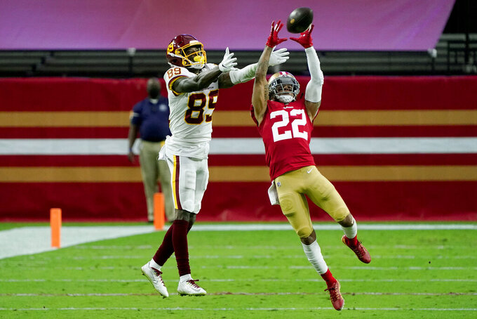 San Francisco 49ers cornerback Jason Verrett (22) intercepts a pass intended for Washington Football Team wide receiver Cam Sims (89) during the first half of an NFL football game, Sunday, Dec. 13, 2020, in Glendale, Ariz. (AP Photo/Rick Scuteri)
