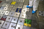 """In this photo taken on Tuesday, July 16, 2019, a worker stands on the Reactor 1 of Ignalina Nuclear Power Plant (NPP) in Visaginas some 160km.(100 miles) northeast of the capital Vilnius, Lithuania. The HBO TV series """"Chernobyl"""" featuring Soviet era nuclear nightmares is drawing tourists to the atomic filming locations in Lithuania. (AP Photo/Mindaugas Kulbis)"""