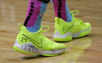 Miami Heat guard Tyler Herro wears inscribed shoes in tribute to NBA basketball player Kobe Bryant and his daughter Gianna before a game against the Boston Celtics, Tuesday, Jan. 28, 2020, in Miami. Bryant and his daughter Gianna were among those that died in a helicopter crash Sunday in California. (AP Photo/Lynne Sladky)
