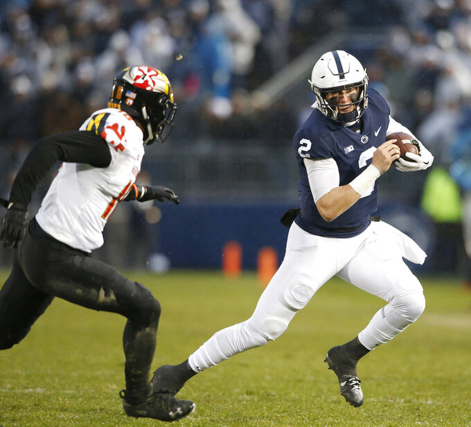 Penn State's Tommy Stevens (2) is chased down by Maryland's Jordan Mosley (18) during the first half of an NCAA college football game in State College, Pa., Saturday, Nov. 24, 2018. (AP Photo/Chris Knight)