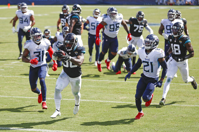 Jacksonville Jaguars running back James Robinson (30) scores a touchdown on a 17-yard run against the Tennessee Titans in the second half of an NFL football game Sunday, Sept. 20, 2020, in Nashville, Tenn. (AP Photo/Wade Payne)