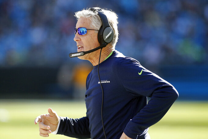 Seattle Seahawks head coach Pete Carroll directs his team against the Carolina Panthers during the first half of an NFL football game in Charlotte, N.C., Sunday, Dec. 15, 2019. (AP Photo/Brian Blanco)