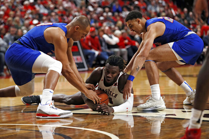 Texas Tech's Chris Clarke (44) dives to steal the ball from Tennessee State's Ben Kone' (34) and Ravel Moody (23) during the first half of an NCAA college basketball game Thursday, Nov. 21, 2019, in Lubbock, Texas. (AP Photo/Brad Tollefson)
