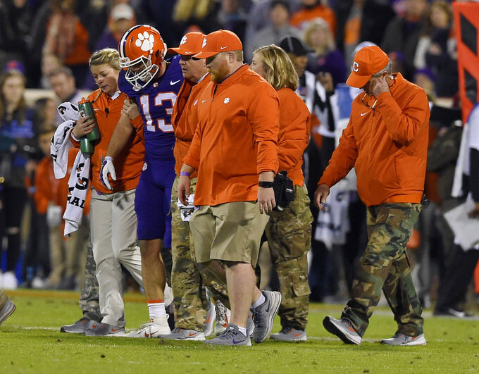 Clemson's Hunter Renfrow is helped off of the field after an injury during the first half of an NCAA college football game against Duke on Saturday, Nov. 17, 2018, in Clemson, S.C. (AP Photo/Richard Shiro)
