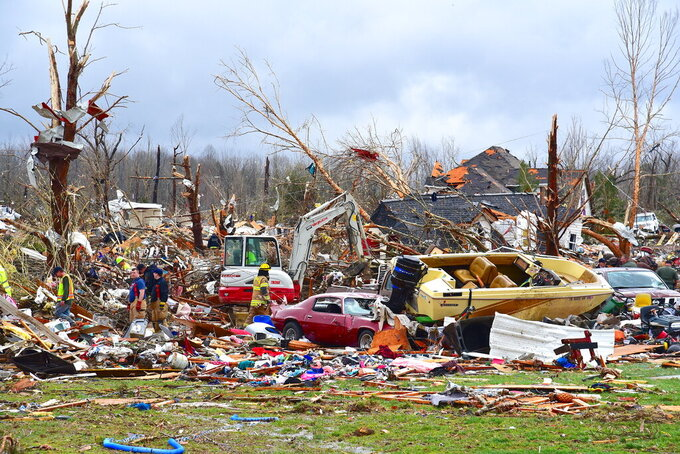 Emergency rescue personnel search for the missing in Cookville, Tenn., where several homes exploded from their foundations during the powerful storm Tuesday, March 3, 2020. (Jack McNeely/The Herald-Citizen via AP)