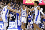 Duke guard Cassius Stanley (2) reacts with guard Jordan Goldwire (14) and guard Tre Jones, right, following a play against Virginia Tech during the first half of an NCAA college basketball game in Durham, N.C., Saturday, Feb. 22, 2020. (AP Photo/Gerry Broome)
