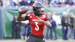FILE - Louisville quarterback Micale Cunningham (3) plays against Mississippi State in the Music City Bowl NCAA college football game Monday, Dec. 30, 2019, in Nashville, Tenn. Last August, Micale Cunningham was recovering from a preseason knee injury that put him behind Jawon Pass on the depth chart. He returned to replace an injured Pass at midseason and didn't look back, passing for 2,065 yards and 22 TDs in 11 starts. (AP Photo/Mark Humphrey, File)