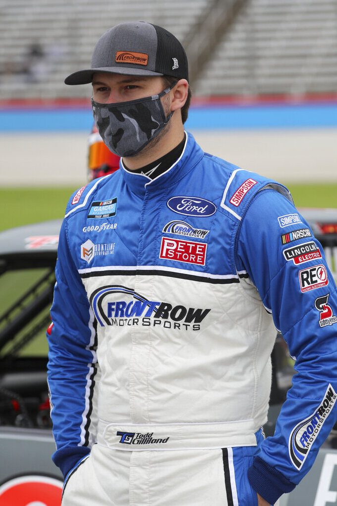 NASCAR Texas Trucks Series driver Todd Gilliland (38) stands on pit road before a NASCAR Cup Series auto race at Texas Motor Speedway in Fort Worth, Texas, Sunday, Oct. 25, 2020. (AP Photo/Richard W. Rodriguez)