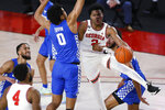 Georgia's Sahvir Wheeler (2) passes the ball around Kentucky Jacob Toppin (0) to Georgia's Andrew Garcia (4) during an NCAA college basketball game Wednesday, Jan. 20, 2021, in Athens, Ga. (Joshua L. Jones/Athens Banner-Herald via AP)
