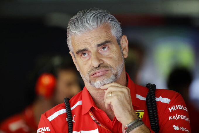 "FILE - In this Sept. 1, 2018 file photo, Ferrari's team Chief Maurizio Arrivabene waits for the start of the third free practice at the Monza racetrack, in Monza, Italy. Ferrari has replaced Maurizio Arrivabene with Mattia Binotto as team principal following another failed Formula One title chase. Binotto had been working as Ferrari's chief technical officer, having been with the team for nearly 25 years. Ferrari says in a statement, ""After four years of untiring commitment and dedication, Maurizio Arrivabene is leaving the team. The decision was taken together with the company's top management after lengthy discussions related to Maurizio's long term personal interests as well as those of the team itself."" (AP Photo/Luca Bruno, File)"