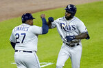 Tampa Bay Rays' Randy Arozarena, right, celebrates his home run off Chicago White Sox relief pitcher Garrett Crochet with third base coach Rodney Linares during the eighth inning of a baseball game Monday, June 14, 2021, in Chicago. (AP Photo/Charles Rex Arbogast)