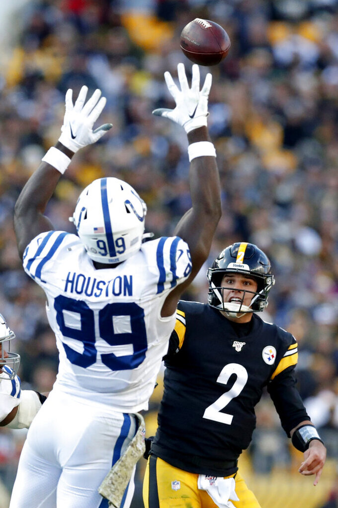 Pittsburgh Steelers quarterback Mason Rudolph (2) passes over Indianapolis Colts defensive end Justin Houston (99) during the second half an NFL football game, Sunday, Nov. 3, 2019, in Pittsburgh. (AP Photo/Don Wright)