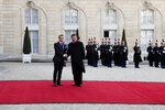 French President Emmanuel Macron, left, welcomes his Chinese counterpart Xi Jinping prior to a meeting at the Elysee Palace, in Paris, Monday, March 25, 2019. Chinese President Xi Jinping is on a 3-day state visit in France where he is expected to sign a series of bilateral and economic deals on energy, the food industry, transport and other sectors. (AP Photo/Thibault Camus)