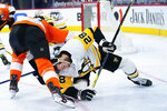 Pittsburgh Penguins' Marcus Pettersson, right, collides with Philadelphia Flyers' Sean Couturier during the third period of an NHL hockey game, Tuesday, May 4, 2021, in Philadelphia. (AP Photo/Matt Slocum)