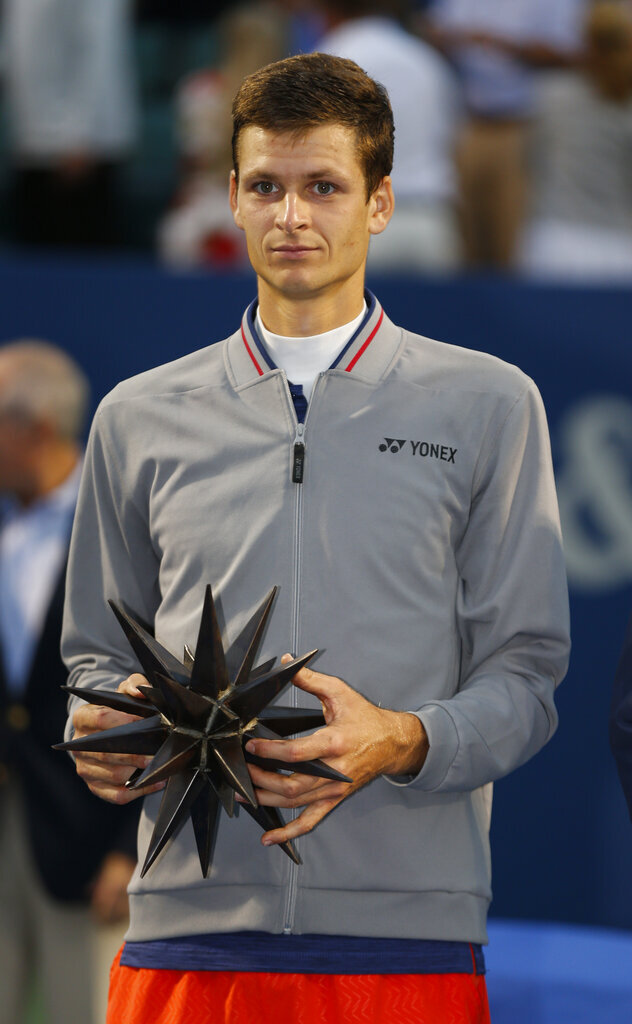 Hubert Hurkacz, of Poland, holds his trophy after winning the Winston-Salem Open tennis tournament over Benoit Paire, of France, in Winston-Salem, N.C., Saturday, Aug. 24, 2019. (AP Photo/Nell Redmond)