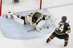 Boston Bruins goaltender Jaroslav Halak (41) blocks a shot by Vegas Golden Knights center Oscar Lindberg (24) during the shootout in an NHL hockey game Wednesday, Feb. 20, 2019, in Las Vegas. (AP Photo/John Locher)