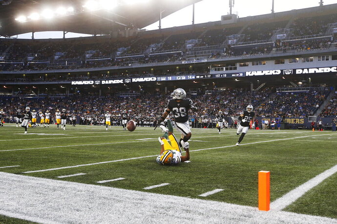 Green Bay Packers' Equanimeous St. Brown (19) misses the pass in the modified end zone as Oakland Raiders' Keisean Nixon (38) defends during the first half of an NFL preseason football game Thursday, Aug. 22, 2019, in Winnipeg, Manitoba. (John Woods/The Canadian Press via AP)