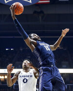 Georgetown's Jessie Govan (15) rebounds against Xavier's Tyrique Jones (0) during the second half of an NCAA college basketball game, Wednesday, Jan. 9, 2019, in Cincinnati. (AP Photo/John Minchillo)