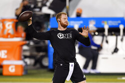 Philadelphia Eagles' Carson Wentz warms up before an NFL football game against the New York Giants, Thursday, Oct. 22, 2020, in Philadelphia. (AP Photo/Derik Hamilton)