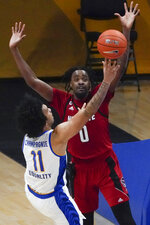North Carolina State's DJ Funderburk (0) defends as Pittsburgh's Justin Champagnie (11) shoots during the first half of an NCAA college basketball game, Wednesday, Feb. 17, 2021, in Pittsburgh. (AP Photo/Keith Srakocic)