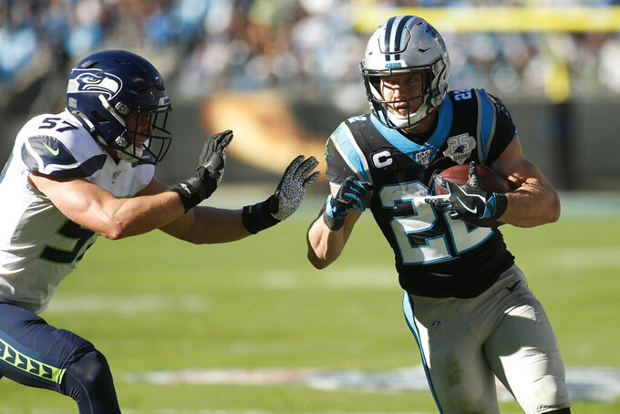Seattle Seahawks linebacker Cody Barton (57) chases Carolina Panthers running back Christian McCaffrey (22) during the first half of an NFL football game in Charlotte, N.C., Sunday, Dec. 15, 2019. (AP Photo/Brian Blanco)
