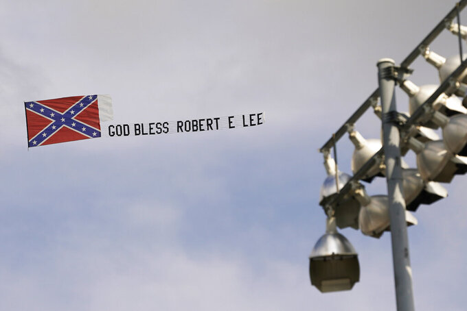 A small plane flies a Confederate flag banner around the racetrack during the NASCAR Xfinity auto race in Richmond, Va., Saturday, Sept. 11, 2021. (AP Photo/Steve Helber)