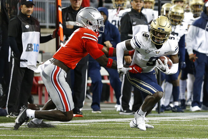 Akron receiver Konata Mumpfield, right, cuts upfield after a catch as Ohio State defensive back Sevyn Banks defends during the first half of an NCAA college football game Saturday, Sept. 25, 2021, in Columbus, Ohio. (AP Photo/Jay LaPrete)