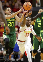 Baylor guard Manu Lecomte (20) grabs a loose ball ahead of Iowa State forward Solomon Young (33) during the first half of an NCAA college basketball game, Saturday, Jan. 13, 2018, in Ames, Iowa. (AP Photo/Charlie Neibergall)
