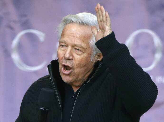 FILE - In this Jan. 27, 2019, file photo, New England Patriots owner Robert Kraft addressing the crowd during an NFL football Super Bowl send-off rally for the team, in Foxborough, Mass. Attorneys for New England Patriots owner Robert Kraft want a Florida judge to block prosecutors from using secretly taken video that police say shows him engaging in paid sex acts with female massage parlor employees. Kraft's attorneys challenged in court documents filed Thursday, March 28, 2019, the warrant allowing Jupiter police officers to hide video cameras in the Orchids of Asia Day Spa. (AP Photo/Steven Senne, File)