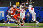 Ohio State defensive tackle Tommy Togiai (72) blocks a pass by Clemson quarterback Trevor Lawrence during the second half of the Sugar Bowl NCAA college football game Friday, Jan. 1, 2021, in New Orleans. (AP Photo/Gerald Herbert)