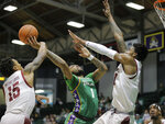 Tulane guard K.J. Lawson (1) is fouled by Temple guard Nate Pierre-Louis (15) during the first half of an NCAA college basketball game New Orleans on Wednesday, Feb. 12, 2020. (David Grunfeld/The Advocate via AP)