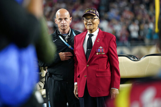 Col. Charles McGee, right, a Tuskegee Airmen during World War II, participates in the coin toss before the NFL Super Bowl 54 football game between the San Francisco 49ers and the Kansas City Chiefs Sunday, Feb. 2, 2020, in Miami Gardens, Fla. (AP Photo/David J. Phillip)
