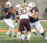 Illinois quarterback AJ Bush, Jr. (1) looks for an open man in the second half of a NCAA college football game against Minnesota, Saturday, Nov. 3, 2018, in Champaign, Ill. (AP Photo/Holly Hart)