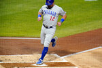 Chicago Cubs' Kyle Schwarber scores from third on a bunt single by Javier Baez during the second inning of a baseball game against the Pittsburgh Pirates in Pittsburgh, Monday, Sept. 21, 2020. (AP Photo/Gene J. Puskar)