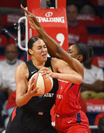 Washington Mystics forward LaToya Sanders, right, guards Las Vegas Aces center Liz Cambage during the first half of Game 1 of a WNBA playoff basketball series Tuesday, Sept. 17, 2019, in Washington. (AP Photo/Nick Wass)