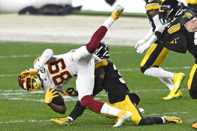 Washington Football Team wide receiver Cam Sims (89) is tackled by Pittsburgh Steelers strong safety Terrell Edmunds (34) during the second half of an NFL football game in Pittsburgh, Monday, Dec. 7, 2020. (AP Photo/Barry Reeger)
