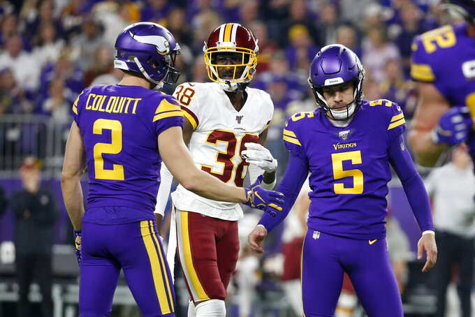 Minnesota Vikings kicker Dan Bailey (5) celebrates with teammate Britton Colquitt, left, in front of Washington Redskins defensive back Simeon Thomas (38) after kicking a 50-yard field goal during the first half of an NFL football game, Thursday, Oct. 24, 2019, in Minneapolis. (AP Photo/Bruce Kluckhohn)