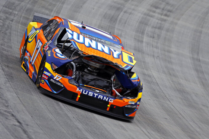 Driver Ricky Stenhouse Jr. (17) drives a damaged car during a NASCAR Cup Series auto race, Sunday, April 7, 2019, in Bristol, Tenn. (AP Photo/Wade Payne)