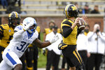 Missouri quarterback Connor Bazelak, right, throws under pressure from Kentucky linebacker Jamar Watson (31) during the first half of an NCAA college football game Saturday, Oct. 24, 2020, in Columbia, Mo. (AP Photo/L.G. Patterson)