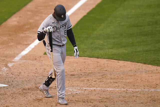 Chicago White Sox's Luis Robert walks toward the dugout after striking out against the Oakland Athletics during the ninth inning of Game 3 of an American League wild-card baseball series Thursday, Oct. 1, 2020, in Oakland, Calif. (AP Photo/Eric Risberg)