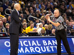 DePaul head coach Dave Leitao, left, is charged with a technical foul after DePaul was charged with a foul against Marquette during the first half of an NCAA college basketball game, Wednesday, Jan. 23, 2019, in Milwaukee. (AP Photo/Darren Hauck)
