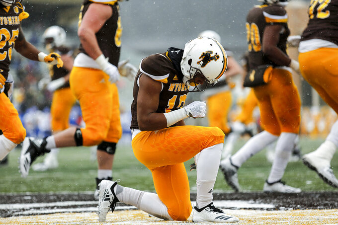 Wyoming wide receiver Raghib Ismail Jr. (17) takes a moment in the end zone after scoring a touchdown against Air Force during an NCAA college football game at War Memorial Stadium Saturday, Nov. 17, 2018, in Laramie, Wyo. (Josh Galemore/The Casper Star-Tribune via AP)