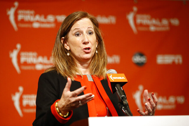 """FILE - In this Sept. 29, 2019, file photo, WNBA Commissioner Cathy Engelbert speaks at a news conference before Game 1 of basketball's WNBA Finals between the Connecticut Sun and the Washington Mystics, in Washington. The WNBA has announced plans to play a reduced season, with a 22-game schedule that would begin in late July without fans in attendance. """"There's a lot to do between now and the tip of the season, now that we've selected IMG Academy"""" as the location to play, WNBA Commissioner Cathy Engelbert said in a phone interview Monday, June 15, 2020.  (AP Photo/Patrick Semansky, File)"""