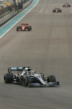 Mercedes driver Lewis Hamilton of Britain leads on Ferrari driver Charles Leclerc of Monaco during the Emirates Formula One Grand Prix, at the Yas Marina racetrack in Abu Dhabi, United Arab Emirates, Sunday, Dec.1, 2019. (AP Photo/Hassan Ammar)