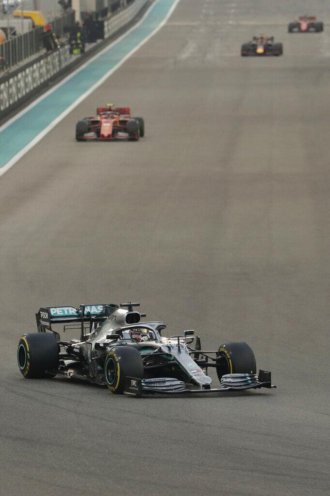 Mercedes driver Lewis Hamilton of Britain leads on Ferrari driver Charles Leclerc of Monaco during the Emirates Formula One Grand Prix, at the Yas Marina racetrack in Abu Dhabi, United Arab Emirates, Sunday, Dec.1, 2019. (AP Photo/Hassan Ammar)