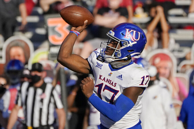 FILE - In this Nov. 7, 2020, file photo, Kansas quarterback Jalon Daniels (17) throws in the first half of an NCAA college football game against Oklahoma in Norman, Okla. (AP Photo/Sue Ogrocki, File)