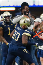 Georgia Tech defensive lineman Makius Scott (90) celebrates with defensive line coach Larry Knight after a defensive stop during the first half of an NCAA college football game against North Carolina Saturday, Sept. 25, 2021, in Atlanta. (AP Photo/John Bazemore)
